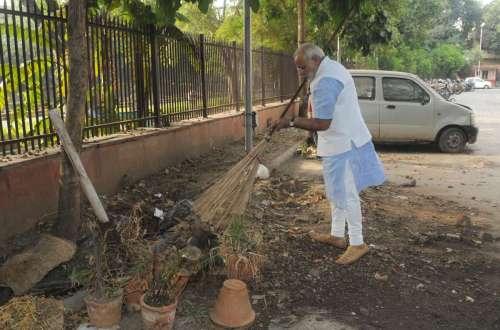 Prime Minister Narendra Modi cleans the premises of Mandir Marg Police Station during his surprise visit, in New Delhi.