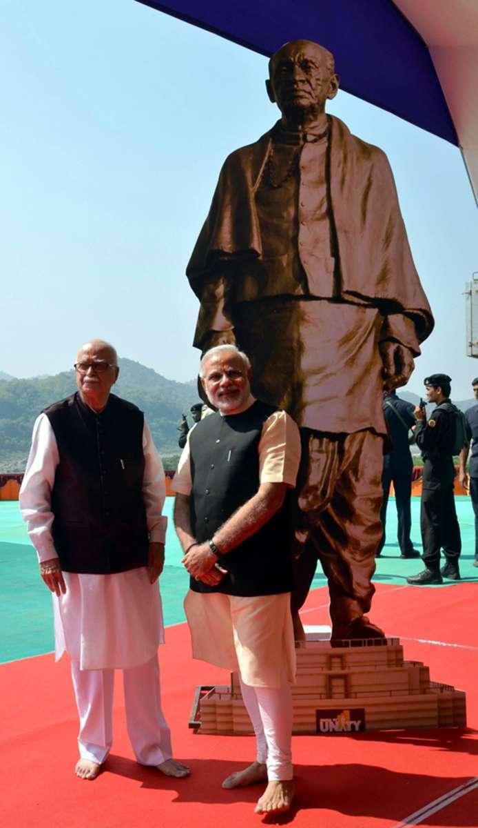 Senior BJP (Bharatiya Janata Party) leader L K Advani with Modi during the foundation stone laying ceremony for Sardar Patel's statue of Unity at Kevadia colony near Sardar Sarovar Dam on Oct.31, 2013 (File)