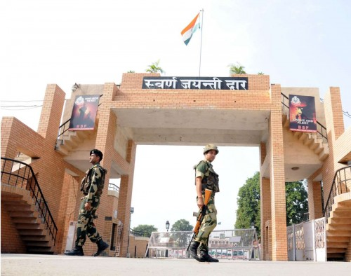 Attari: BSF soldiers guard Swaran Jayanti Dwar at Attari Indo-Pak international border. Security has been beefed-up at the border following a suicide bomb attack at Wagah in Pakistan that left 60 people dead
