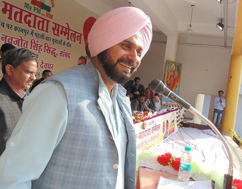 Cricketer turned politician Navjot Singh Sidhu addresses during a public meeting in Kanpur. FILE PHOTO