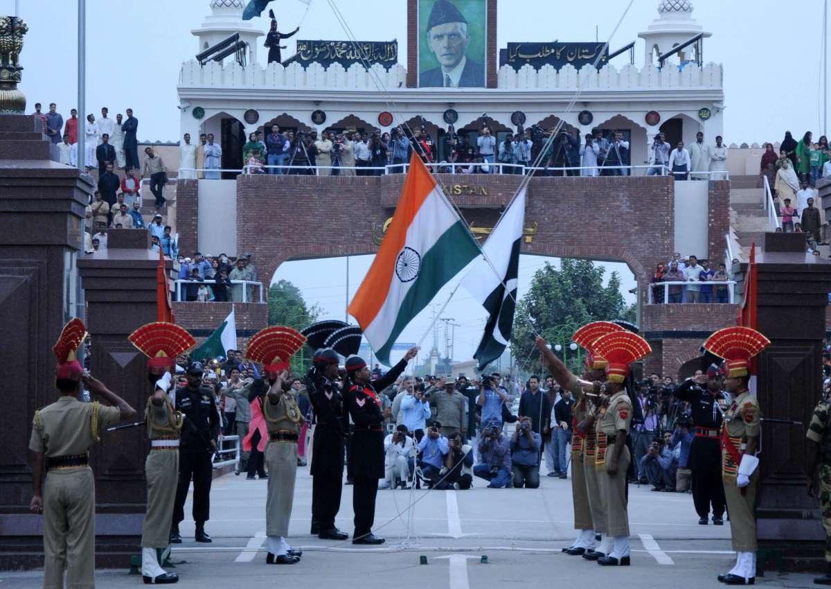 Attari: BSF and Pakistani Rangers soldiers' at Beating Retreat ceremony at Attari-Wagah international border on Nov.3, 2014. (Photo: IANS)