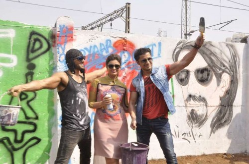 Actors Ranveer Singh, Ali Zafar and Parineeti Chopra painting graffiti on walls during the promotion of their film `Kill Dil` in Mumbai on Nov 8, 2014.