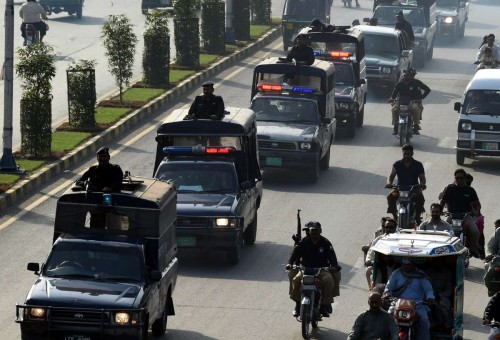 Pakistani police officers patrol on road during flag march on the 7th day of Muharram in eastern Lahore, Pakistan, on Nov. 1, 2014. Muharram, the first month of Islamic calendar, is usually observed for ten days.