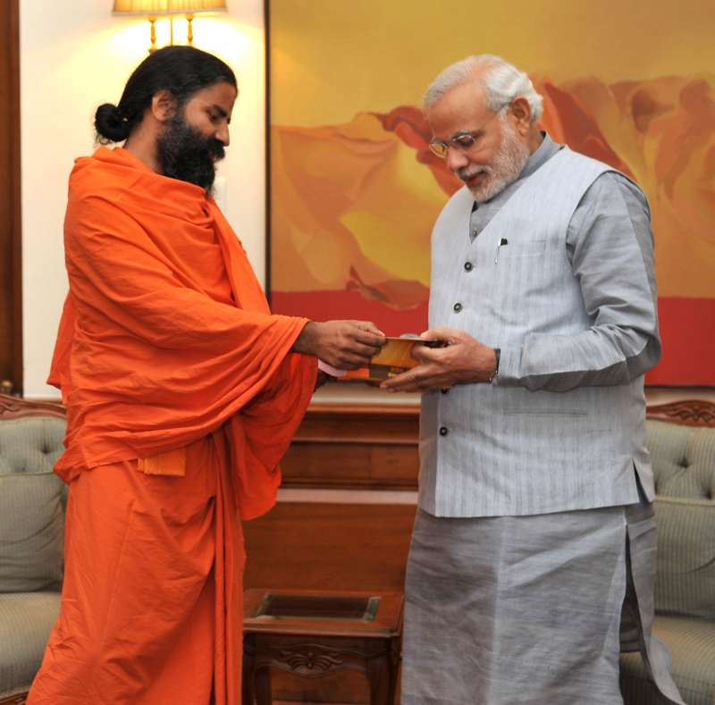 THE BLUNDER: Yoga Guru Ramdev calls on Prime Minister Narendra Modi, in New Delhi. Modi is providing Z Category security to the controversial Guru who faces tax evasion and forex violation charges