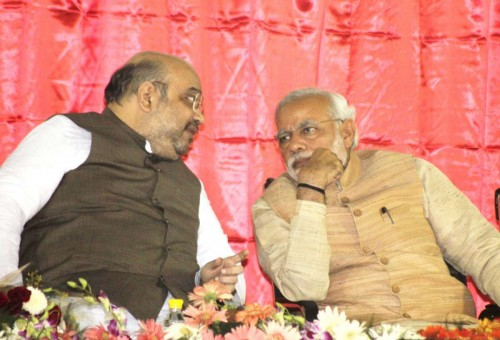 New Delhi: Prime MInister Narendra Modi with BJP president Amit Shah during the launch of BJP membership drive at party headquarters in New Delhi on Nov. 1, 2014. (Photo: Sunil Majumdar/IANS)