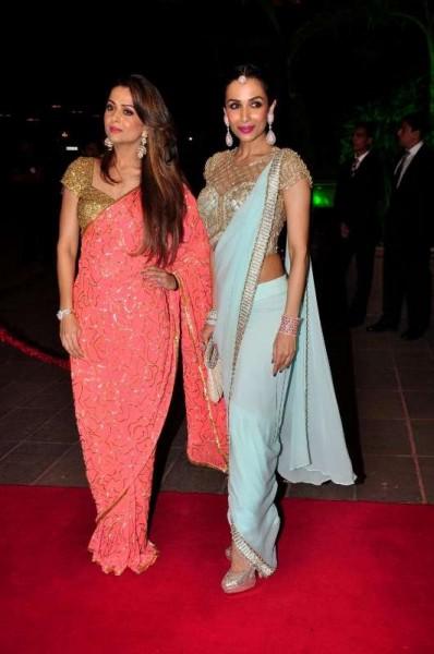 Mumbai: Actor Malaika Arora Khan along with her sister Amrita Arora during Arpita Khan's marriage reception in Mumbai, on November 21, 2014. (Photo: IANS)