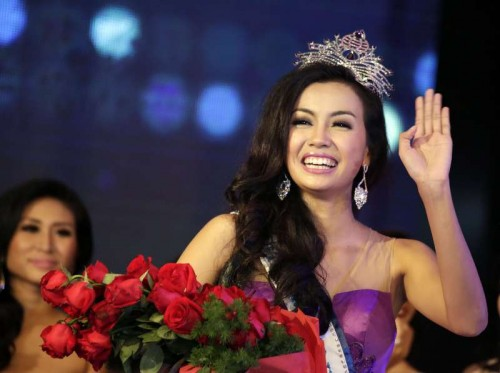 Miss Myanmar World Wyne Lay gestures after winning the crown at the Miss Myanmar World 2014 pageant in Yangon Sept. 27, 2014.