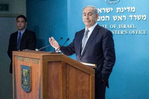 Israeli Prime Minister Benjamin Netanyahu addresses a press conference at the Prime Minister's office in Jerusalem, on Dec. 2, 2014. Israeli Prime Minister Benjamin Netanyahu announced his support for dispersing the Knesset (parliament) and conducting early elections amid a coalition crisis. During a press conference at his Jerusalem office, Netanyahu also said he has ordered to fire Justice Minister Tzipi Livni and Finance Minister Yair Lapid, who he said plotted against him by outspokenly criticizing his policies.