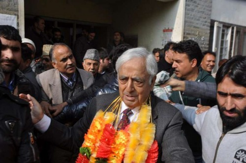 Peoples Democratic Party (PDP) patron Mufti Mohammad Sayeed arrives to file his nomination papers for upcoming Jammu and Kashmir Assembly polls in Anantnag, on Nov 19, 2014.