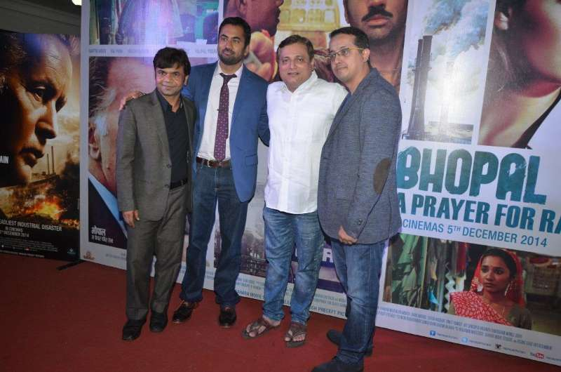 Actors Rajpal Yadav, American actor Kal Penn and Mohan Joshi during the trailer launch of film Bhopal: A Prayer for Rain in Mumbai