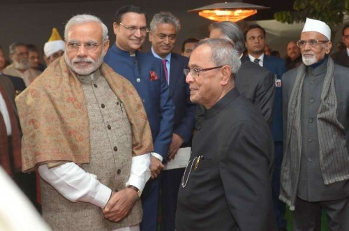President Pranab Mukherjee and Prime Minister Narendra Modi at the inaugural ceremony of the Ceremonial Hall, at the President's Estate, in New Delhi on Dec 12, 2014. Also seen journalists Rajdeep Sardesai and Rajat Sharma.