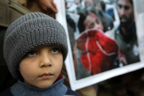 A Pakistani child attends a protest to condemn Tuesday's Taliban attack on the Army Public School, in northwest Pakistan's Peshawar on Dec. 18, 2014. More then 140 people, the vast majority children, were killed at an army-run school in northwestern Pakistani city of Peshawar on Dec.16 in an attack by armed militants.