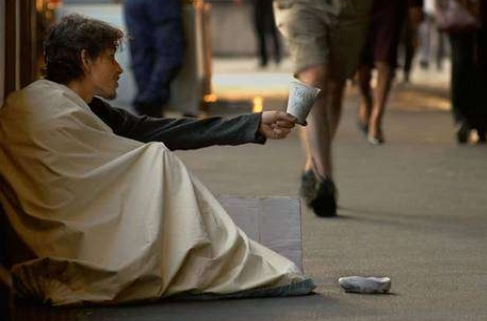 A poor homeless man in one of the streets of Britain