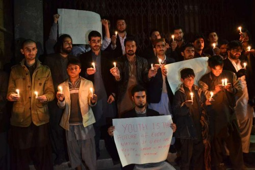 Members of Pakistani civil society light candles for the victims of an attack by militants on a school in southwest Pakistan's Quetta on Dec. 16, 2014. A total of 148 people including 132 students and nine staff members were killed and 133 others injured in Tuesday's terror attack at an army-run public school in Pakistan's northwest city of Peshawar, said a spokesman of the Pakistani army.