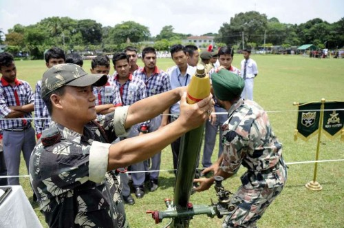 An Indian army personnel demonstrates how to operate mortars to school students during `Know Your Army`- a programme organised by Indian Army at Assam Rifles ground in Agartala.