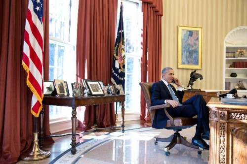 Photo released by the White House shows U.S. President Barack Obama talking on the phone with Alan Gross who was en route to the U.S. from Cuba after being released, in the Oval Office of the White House in Washington Dec. 17, 2014.