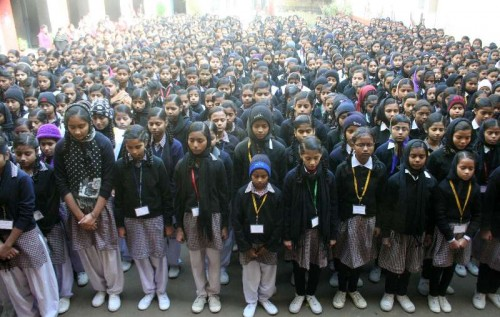 Students participate in a silent protest against Tuesday's attack on the Army Public School in Peshawar, Pakistan, that claimed 104 lives mostly those of children in Varanasi, on Dec 17, 2014.