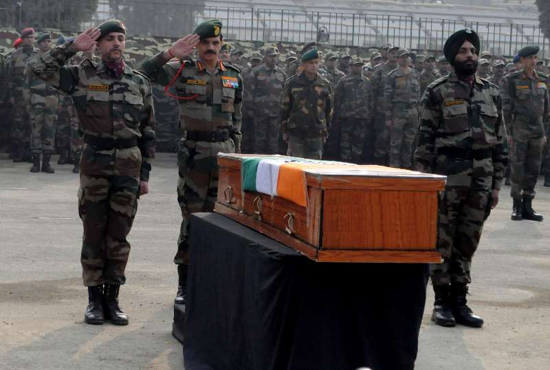 Srinagar: Chief of Army Staff, General Dalbir Singh pay tributes to the soldiers martyred on Friday`s attacks in Jammu and Kashmir at Muhara Uri Army camp, Badami Bagh Cantonment in Srinagar on Dec. 6, 2014. (Photo: IANS)