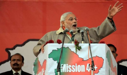 Prime Minister Narendra Modi addresses a rally at Shar-e-Kashmir Cricket Stadium in Srinagar, on Dec 8, 2014.