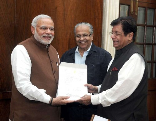 The Member of Parliament and President of the Indian Union Muslim League, Shri E. Ahamed presenting a cheque for Rs 25 lakh rupees to the Prime Minister, Shri Narendra Modi, towards the Prime Minister's National Relief Fund, for flood relief and rehabilitation. The Indian Union Muslim League has extended all support for the Prime Minister's relief activities, in New Delhi on December 03, 2014.