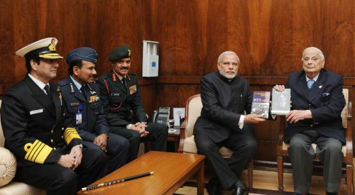 """The Lt. General (Retd.) JFR Jacob presenting his book """"An Odyssey in War & Peace"""" and """"Surrender at Dacca"""" to the Prime Minister, Shri Narendra Modi, in New Delhi on December 16, 2014. The Chief of Army Staff, General Dalbir Singh, the Chief of Naval Staff, Admiral R.K. Dhowan and the Chief of the Air Staff, Air Chief Marshal Arup Raha are also seen."""