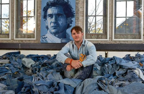 British artist Ian Berry in front of Ayrton Senna portrait he painted.