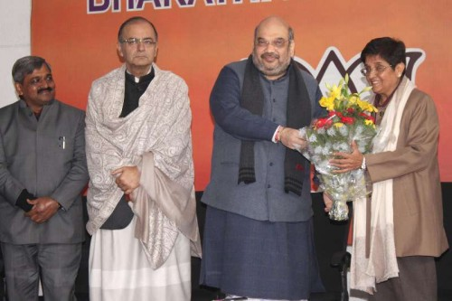 Social activist and former IPS officer Kiran Bedi joins BJP in presence of (L-R) Delhi BJP Chief Satish Upadhyay, Union Minister for Finance, Corporate Affairs, and Information and Broadcasting Arun Jaitley, BJP chief Amit Shah in New Delhi, on Jan 15, 2015.