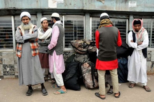Passengers wait for transport at a bus stand during the nationwide strike in Dhaka, Bangladesh, Dec. 31, 2014. Bangladesh's largest Islamist party Jamaat-e-Islami has called a nationwide strike on Wednesday and Thursday in protest against the death sentence handed over to its leader for war crimes against humanity during the country's Liberation War in 1971.