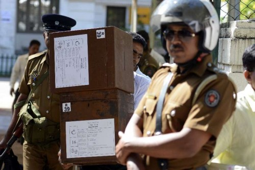 A Sri Lankan election worker carries ballot boxes in Colombo, Sri Lanka, on Jan. 7, 2015. Sri Lankans will go to the polls on Thursday as the incumbent president Mahinda Rajapaksa and his former health minister Maithripala Sirisena battle it out to be Sri Lanka's next president.