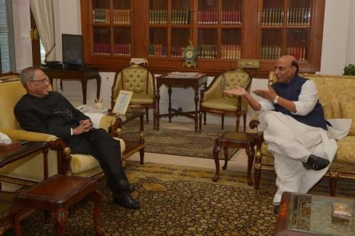 Union Home Minister Rajnath Singh calls on President Pranab Mukherjee to wish him on new year at Rashtrapati Bhavan in New Delhi, on Jan 1, 2015.