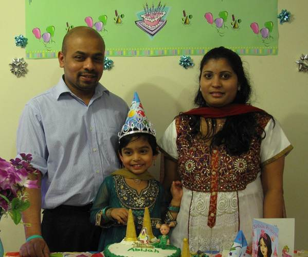 Jaso Manokaran with his wife and children