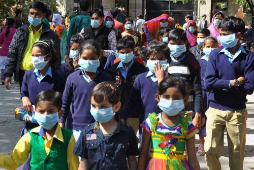 Children wear masks to protect themselves from swine flu in Jaipur, on Feb 18, 2015.