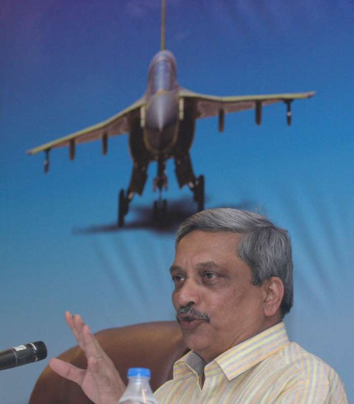 Indian Defence Minister Manohar Parrikar addresses a press conference during the inauguration of Aero India-2015 Air Show at Yelahanka Air-force Station, in Bengaluru on Feb 18, 2015