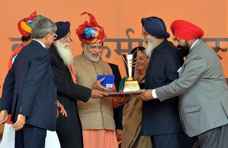 Prime Minister Narendra Modi at the launch of the `Soil Health Card scheme`, at Suratgarh, in Rajasthan on Feb 19, 2015. Also seen Chief Minister of Rajasthan Vasundhara Raje Scindia, Punjab Chief Minister Parkash Singh Badal and other dignitaries.