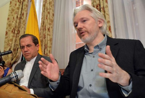 WikiLeaks founder Julian Assange  and Ecuadorian Foreign Minister Ricardo Patino attend a press conference at the Ecuadorian Embassy in London, Britain, Aug. 18, 2014. WikiLeaks founder Julian Assange said on Monday that he would be leaving the Ecuadorian Embassy in London soon, where he had taken refuge for two years. (Xinhua/Press Association/John Stillwell) (srb)