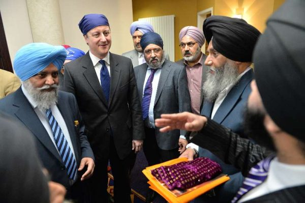 Prime Minister David Cameron during the election campaign visited the Sikh Temple in Leamington Spa which serves the 4,000 local Sikhs. The Prime Minister took part in the prayer ceremony and spoke to members of the community. (File)