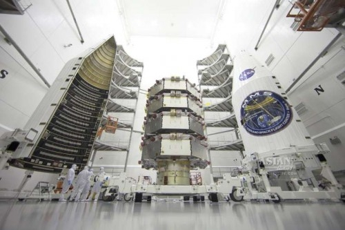 NASA's Magnetospheric Multiscale (MMS) observatories are shown here in the clean room being processed for launch March 12.