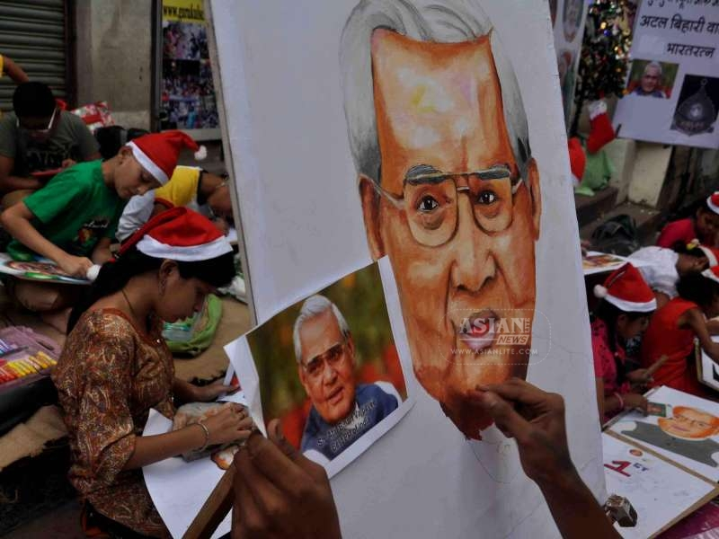 Students participate in a painting competition organised by Gurukul drawing school on the eve of former prime minister Atal Bihari Vajpayee in Mumbai