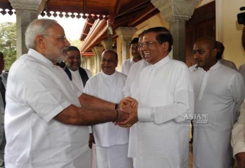 Prime Minister Narendra Modi with Sri Lankan President Maithripala Sirisena during his visit to the Sri Maha Bodhi Tree in Anuradhapura, Sri Lanka on March 14, 2015.