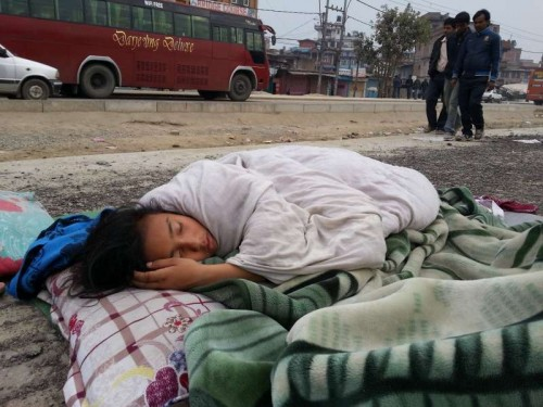 A little girl sleeps on road side in Kathmandu, Nepal, April 26, 2015. Death toll from Nepal earthquake surpasses 1,800, and over 4,700 people were injured, Home Minnistry of Nepal.