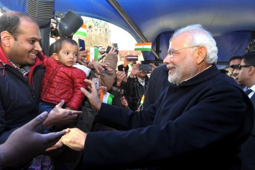 Prime Minister Narendra Modi being greeted by the members of the Indian community on his arrival in Hannover, Germany on April 12, 2015.