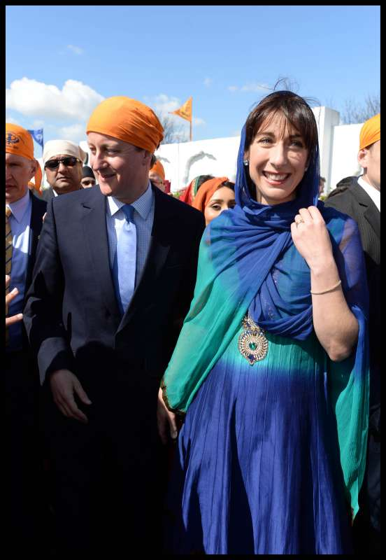 Prime Minister David Cameron and wife Samantha at the nagarkirtan in Kent. Picture by Andrew Parsons  i-Images