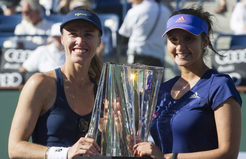 Martina Hingis (left) and Sania Mirza with the BNP Paribas Cup trophy at the awards ceremony. Martina Hingis and Sania Mirza won a 2-0 victory over Russia's Elena Vesnina and Ekaternia Makarova at the Indian Wells BNP Paribas Open women's doubles final on March 21, 2015.