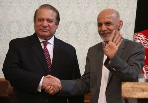Afghan President Ashraf Ghani (R) shakes hands with Pakistani Prime Minister Nawaz Sharif after a joint press conference in Kabul, Afghanistan on May 12, 2015. Pakistani Prime Minister Nawaz Sharif said Tuesday that a peaceful Afghanistan would benefit Pakistan and Islamabad supports the Afghan-led and Afghan-owned peace process