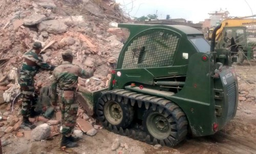 Indian Army Engineers involved in the rescue operation, at Barpak, in Nepal