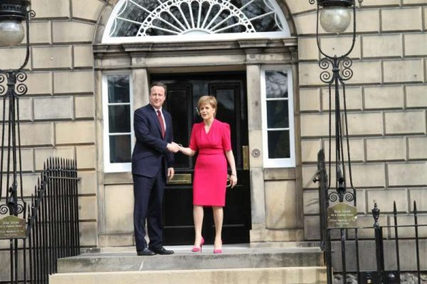 British Prime Minister David Cameron with Scottish First Minister Nicola Sturgeon in Glasgow after the meeting to discuss devolution
