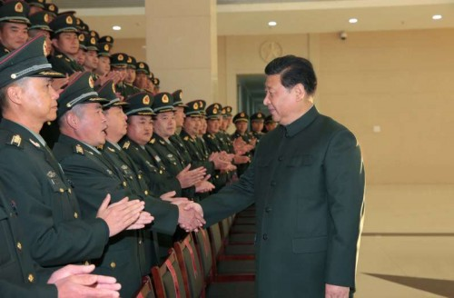 Chinese President Xi Jinping (R), also general secretary of the Communist Party of China (CPC) Central Committee and chairman of the Central Military Commission, meets with senior officers of the 14th army group in Kunming, capital city of southwest China's Yunnan Province