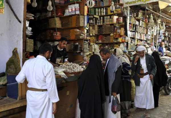 Buying food in a market one day ahead of the holy month of Ramadan