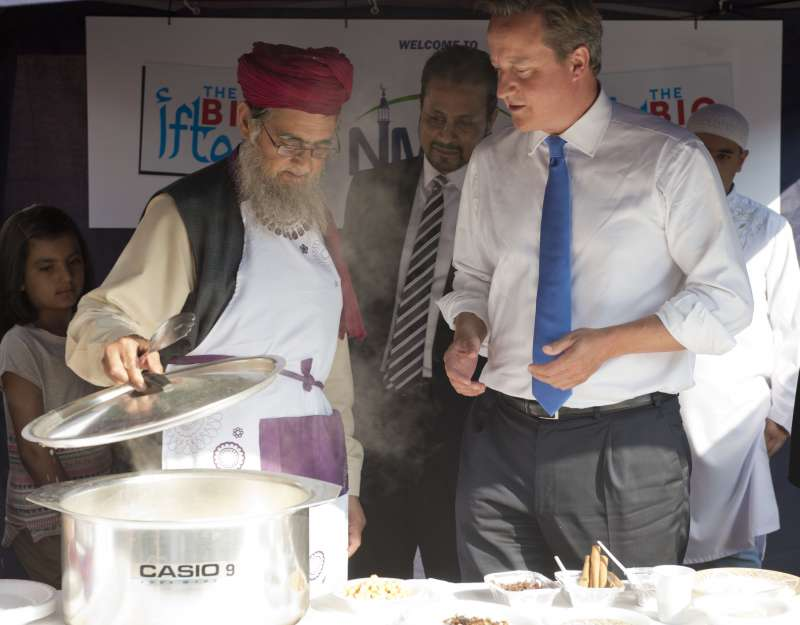 Prime Minister David Cameron is experimenting  his samosa making skills during a mosque visit in Manchester