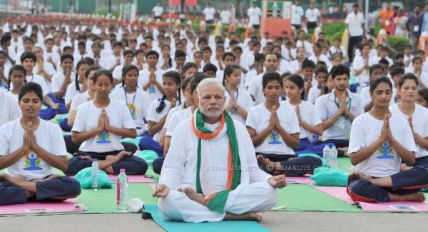Prime Minister Narendra Modi participates in the mass yoga demonstration at Rajpath on the occasion of International Yoga Day in New Delhi  7